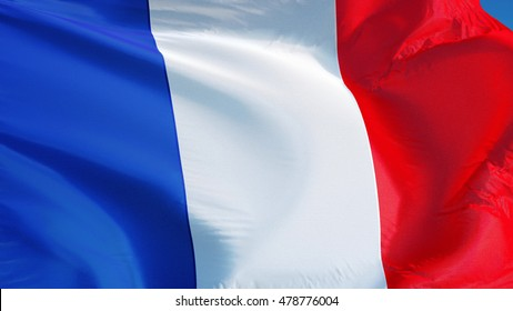 France flag waving against clean blue sky, close up, isolated with clipping path mask alpha channel transparency