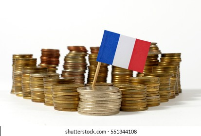 France flag waving with stack of money coins