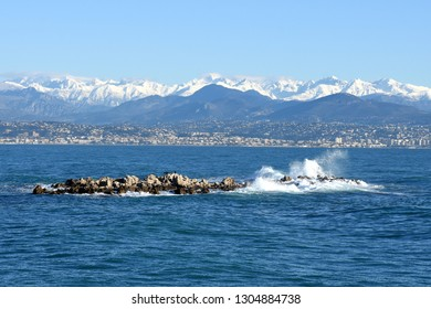 France, french riviera, massif of Mercantour and Grenille island seen from the Cape of Antibes, landscape sea and mountain.