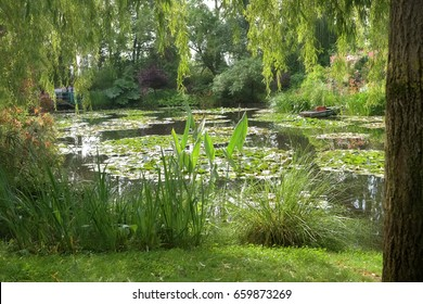 FRANCE, GIVERNY - JULY, 29, 2014: Claude Monet's house and garden with lily pond.