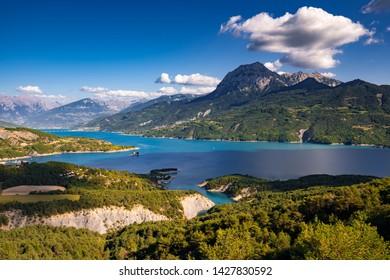 France, Hautes-Alpes (05), Baie-Saint-Michel. Serre-Poncon Lake and Grand Morgon peak in Summer. Durance Valley, European Alps, Provence-Alpes-Cote d'Azur (PACA)