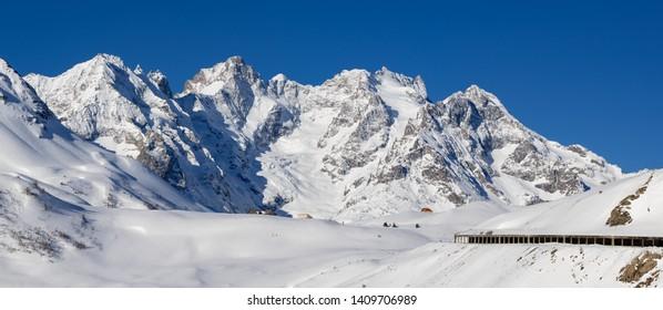 France, Hautes-Alpes (05), Ecrins National Park - Winter panoramic view of Lautaret Pass (Col du Lautaret) with La Meije and Gaspard peaks. European Alps