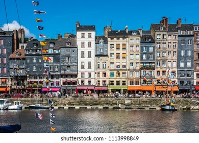 FRANCE, HONFLEUR - MAY 30: Honfleur harbour in Normandy, France. Color houses and their reflection in water on May 30, 2015