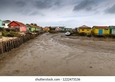 France, Island of Oléron, 05/11/2018, Make-shift wooden cabins used for the Oyster Farming Business, some transformed for Artists. A must see location in France.  Located in a old harbour.