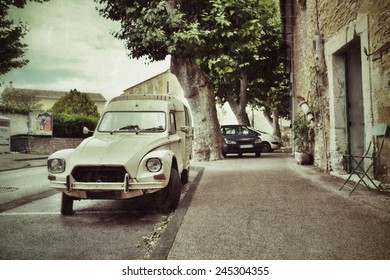 FRANCE- JUL 13, 2014: Beautiful street with retro car in medieval village of Villes sur Auzon. France is most-visited country by international tourist arrivals in 2013 by UNWTO rank. Filtered image