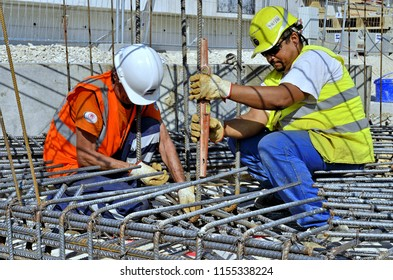 Besançon, France - July 23, 2013: Workers on a construction site.