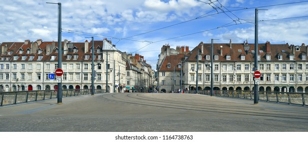 Besançon, France - June 24, 2018: Panoramic view of the Pont Battant with its tramway tracks and catenaries, and the Quai Vauban and the beginning of the pedestrian street in the background.