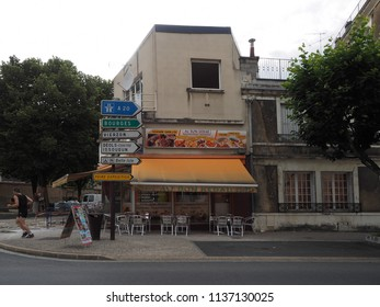 Châteauroux, France - June 3, 2018. Ethnic restaurant and street with driving directions.