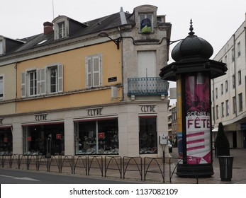 Châteauroux, France - June 3, 2018. Historic center and old artistic column showing advertising images.