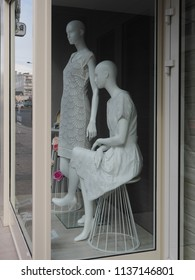 Châteauroux, France - June 3, 2018. Mannequins in the window of a women's clothing store.