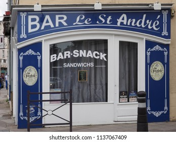 Châteauroux, France - June 3, 2018. Snack bar in the historic center, colored shop window.