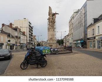 Châteauroux, France - June 3, 2018. Square with war memorial. Delivery pizza scooters.
