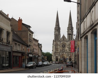Châteauroux, France - June 3, 2018. Street in the historic center, in the background the Catholic Church Notre Dame de Chateauroux.