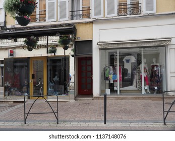 Châteauroux, France - June 3, 2018. Street with shops in the historic centre.