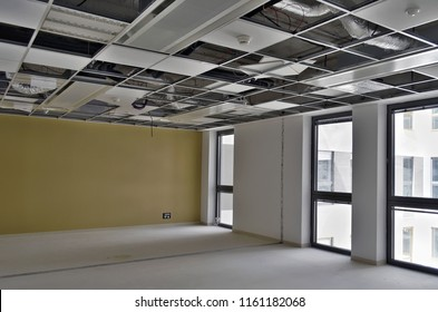 Besançon, France - June 4, 2015: Suspended ceiling not finished in a empty room of a construction site.