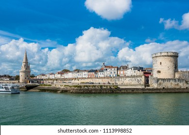 FRANCE, LA ROCHELLE - SEPTEMBER 21, 2015: View of Old Harbour towers of La Rochelle France ancient fortress.