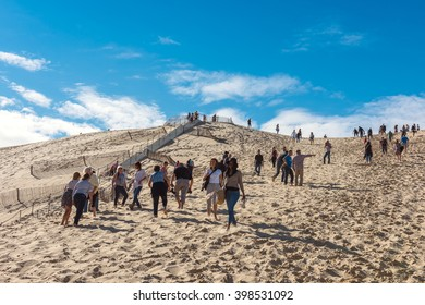FRANCE, LA TESTE-DE-BUCH - SEPTEMBER 19: people visiting the famous highest sand dune in Europe Dune of Pyla on September 19, 2015