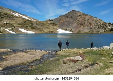 France landscape Pyrenees mountain lake with fishermen, Casteilla, Pyrenees-Orientales