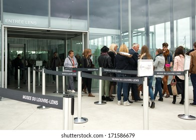 FRANCE, LENS - SEPTEMBER 19, 2013: Visitors wait in the entrance of the Louvre-Lens. This art museum, located in Lens, Pas-de-Calais, Northern France, was inaugurated on December 4, 2012