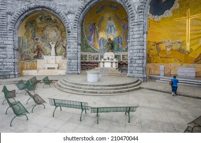 FRANCE LOURDES SEP 6: view of woman praying near of basilica in Lourdes town on 6 September 2013. The town is a place where st Mary appeared before a peasant girl