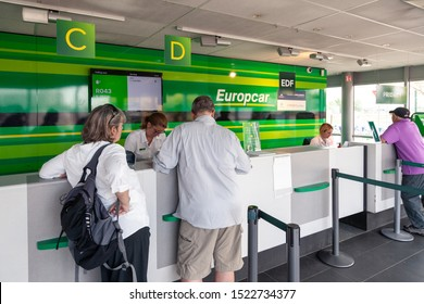 France Lyon 2019-06-18 Europcar car rental desk, employee register a rental contract for customers at Lyon Airport in France. Europcar has a fleet of 200,000 vehicles in 140 countries