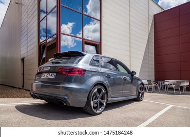 France Lyon 2019-06-20 closeup back view of premium sports car dark gray hatchback Audi RS 3, low profile tires, cast disk, red caliper car produced by German automobile manufacturer Audi AG