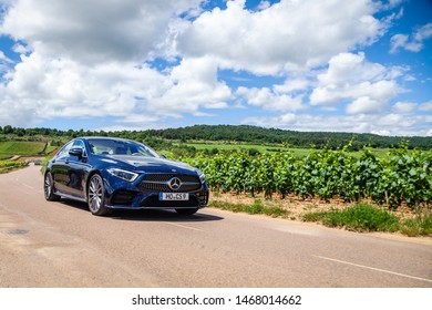France Lyon 2019-06-20 closeup front view luxury dark blue German car sedan premium Mercedes CLA with EU registration number on road at french vineyards. Concept wine travel in Beaune, Burgundy