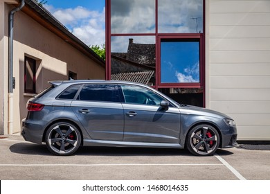 France Lyon 2019-06-20 closeup side view of premium sports car dark gray hatchback Audi RS 3, low profile tires, cast disk, red caliper car produced by German automobile manufacturer Audi AG