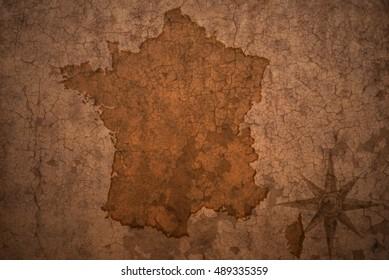 france map on a old vintage crack paper background