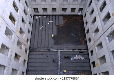 Besançon, France - March 18, 2014: Waterproofness work on a construction site.