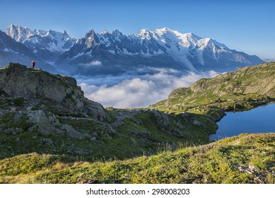 France, Mont Blanc, Lake Cheserys, hiker in front of Mount Blanc at sunrise