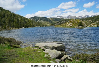 France mountain lake with the Carlit massif in background, Pyrenees-Orientales, Estany de la Pradella, natural park of the Catalan Pyrenees
