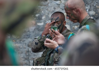 France, Normandy, June 6, 2011 - Army soldiers make face camouflage before tactical exercises in Normandy.