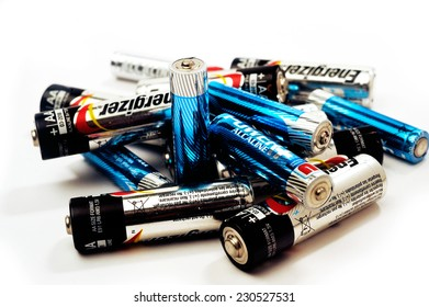 FRANCE - NOVEMBER 9: Recycling of used batteries of different brands on white background, november 9, 2014.
