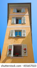 FRANCE. Old town architecture of Nice on French Riviera. Narrow facade of the building with shuttered Windows decorated with flowers