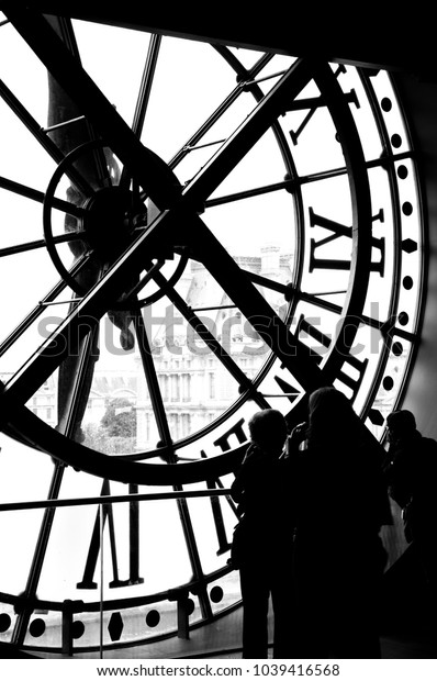 France, Paris - 04 June 2012: Musée d'Orsay. People watching through the clock window black and white