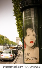 France / Paris - 05/05/2014 : An advertisement or advertising on a billboard in the champs élysées in Paris, an old vintage promotion pillar in the street.