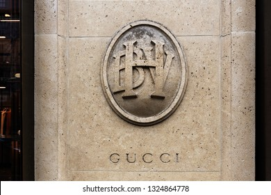 France, Paris, 2018, 4th arrondissement, Bazar de l'Hôtel de Ville entrance with Gucci logo carved into the pillar.