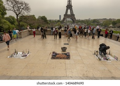 France, Paris, 2019/04, illegal souvenir sellers lay out their miniature Eiffel Towers on carpets
