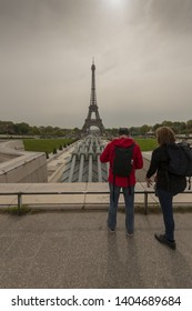 France, Paris, 2019/04, Tourists pause at the Trocadero facing the Eiffel Tower.