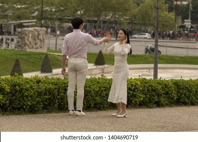 France, Paris, 2019-04,  Young married couples come from all over the world to pose for photographers, in a romatic atmosphere.