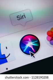 France, Paris - April 18, 2018:  New Siri icon application in a dock on a screen of macbook, close-up.