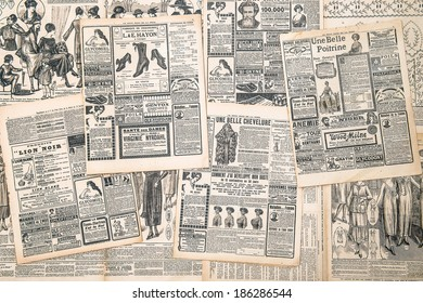 FRANCE, PARIS - CIRCA 1919: newspaper pages with antique advertisement. Woman's fashion magazine Le Petit Echo de la Mode