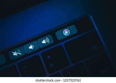 France, Paris - June 25, 2018:  New Siri icon application button on the Touch Bar  of macbook keyboard, close-up.