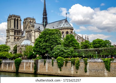 FRANCE, PARIS, MAY, 20, 2014 - Notre-Dame de Paris or Cathedral of Our Lady of Paris viewed from River Seine. French Gothic architecture on island Cite.