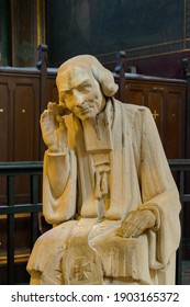 France, Paris, September 26, 2014: Sculpture of St. Jean-Marie Vianney, French Parish Priest, circa 1986 in catholic cathedral.
