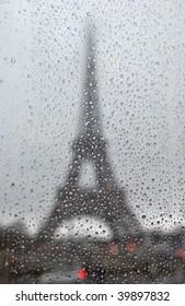 France. Paris. Silhouette of Tour Eiffel through the window with rain drops