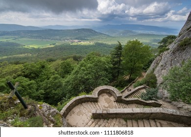 France, Plan D'Aups, 29 May 2018: Grotto of Mary Magdalene, Massif St Baum, holy fragrance, holy grotto, the Monastery of Dominican Friars, Statue of Mary Magdalene, stairs to an entrance