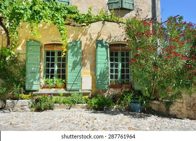 France, Provence. Vaison la Romaine. Typical medieval houses decorated with green plant and flowers in pots.