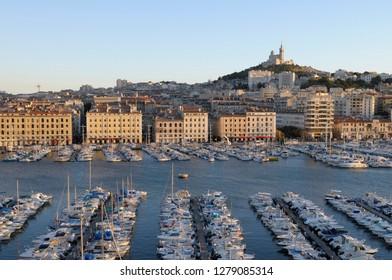 France, Provence-Alpes-Cote d'Azur, Bouches-du-Rhone, Marseille. Vieux-Port with Basilique Notre Dame de la Garde on the hill in the background